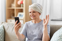 senior woman having video call on smartphone