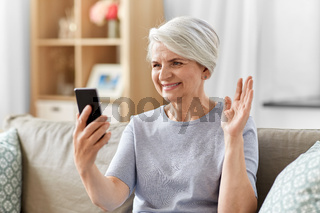 senior woman having video call on smartphone