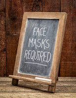 face masks required, blackboard sign