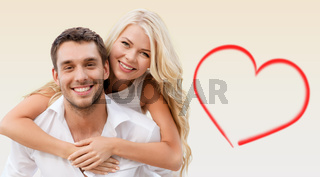 happy couple having fun over beige background