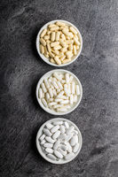 White medical pills. Pharmaceutical medicine pills, tablets and capsules.