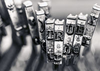 the word TRUE with old typwriter keys