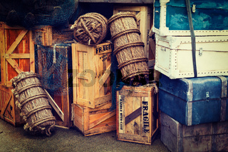Retro hipster style travel image of vintage luggage and crates