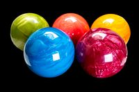 colorful bowling balls isolated on black background.