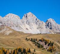 Autumn alpine mountain lake near San Pellegrino Pass, Trentino, Dolomites Alps, Italy.