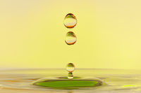 High speed water drop photograph with falling drops