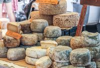 Stand with cheese in the market in Gordes