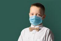 Happy school boy in mask