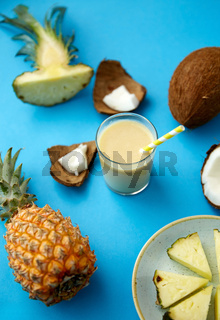 pineapple, coconut and drink with paper straw