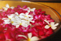 Flowers in bowl for spa procedures