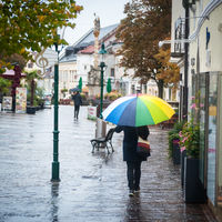 shopping in rainny weather with an umbrella