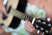 Woman Playing Ccoustic Guitar Abstract.