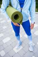 Close-up woman holding roll fitness after working