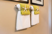 Beautiful Star Fish Decor Detail of Towels Hanging In Bathroom