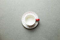 Empty coffee cup on gray background. top view