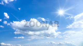 typical beautiful blue sky sun clouds background