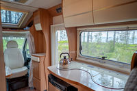 View from the window of the motorhome RV Caravan car travel Vacation.
