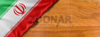 National flag of Iran on a wooden background with copy space