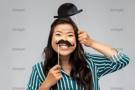 asian woman with vintage moustaches and bowler hat