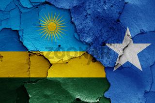 flags of Rwanda and Somalia painted on cracked wall