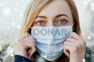young woman wearing protective medical mask