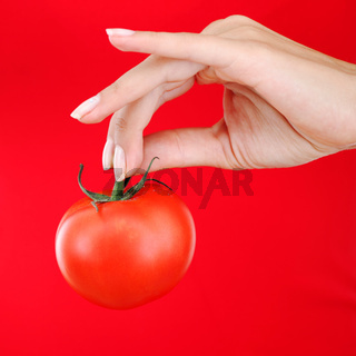 Tomato in woman hand