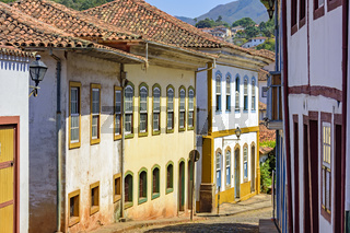 Quiet street with old colorful houses in colonial architecture, cobblestones and lanterns