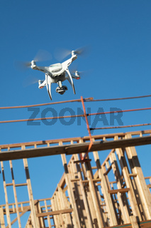 Drone Quadcopter Flying and Inspecting Wood Framing at Construction Site