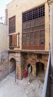Patio of ottoman historic Waseela Hanem House with wooden oriel windows