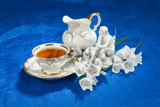 Tea, Statuette And Flowers