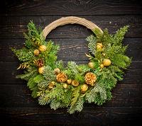 Christmas wreath on dark wooden background