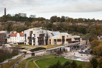 The modern Scottish Paralment building in the Holyrood area of Edinburgh, Scotland. Calton Hill in t