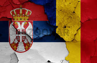 flags of Serbia and Romania painted on cracked wall
