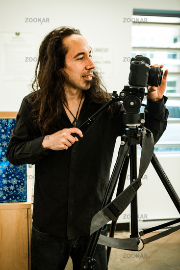 Behind the camera lens of a videographer