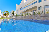 Torrevieja, Spain - June 2, 2020: Modern residential complex with swimming pool. Concept of rented apartment summer holidays, new home buying, loan and lending. No people. Spain, Costa Blanca. España