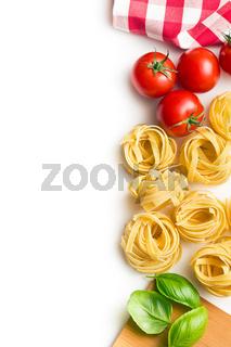italian pasta tagliatelle, tomatoes and basil leaves