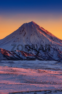 Beautiful winter volcanic landscape of Kamchatka Peninsula at sunrise
