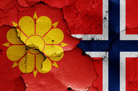 flags of Trondheim and Norway painted on cracked wall