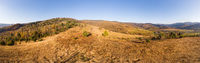 Aerial drone view 180 degrees panoramic scenic landscape of mountains and forests, slopes and valleys. Carpathians, Eastern Beskids