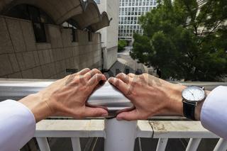 Hands on railings