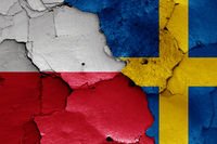 flags of Poland and Sweden painted on cracked wall