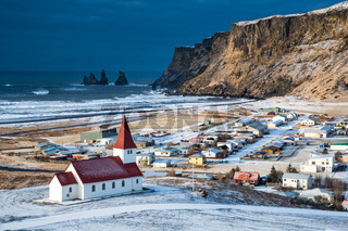 Icelandic village of Vik,  with the Myrdal  church at the top of the hill offering picturesque images of the community covered in snow in Spring.
