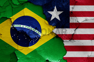 flags of Brazil and Liberia painted on cracked wall