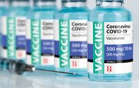 Coronavirus COVID-19 Vaccine Vials and Syringe On Reflective Surface