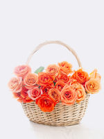Wicker basket with orange roses