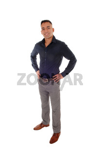 Young man standing with his hands on his hips