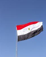 National flag of Egypt flying high against the blue sky