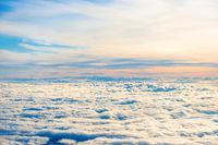 Aerial view of blue sky with layers of white clouds