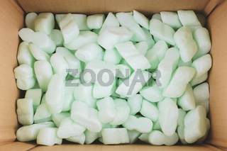 box filled with polystyrene foam peanuts packaging filler cushioning material