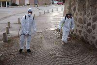 Workers spray disinfectant COVID-19 coronavirus